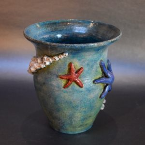 Teal Raku Pot with Sea Stars and Barnacles by Ed Oldfield